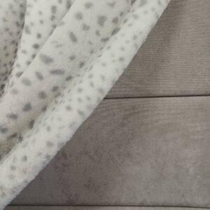 Snow Leopard Super Soft Throw over Headboard